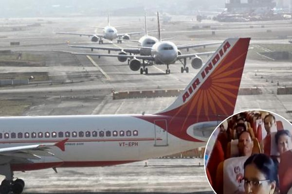 Inflamed passengers using papers to reduce heat in Air India flight